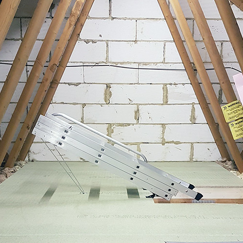 Folded aluminium loft ladder above hatch