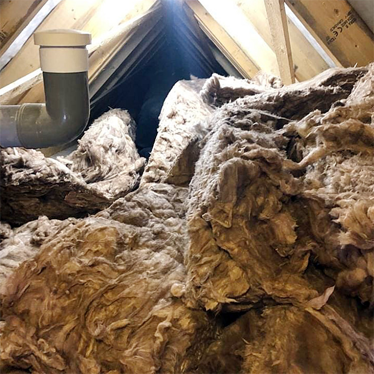 Massive piles of old insulation for lofts