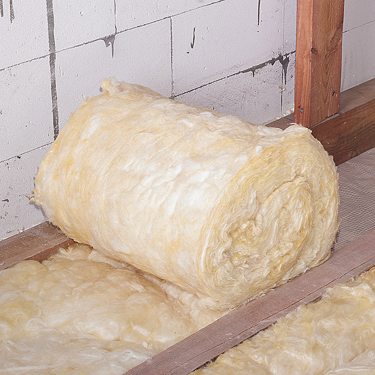 Roll of yellow loft insulation fitted on loft