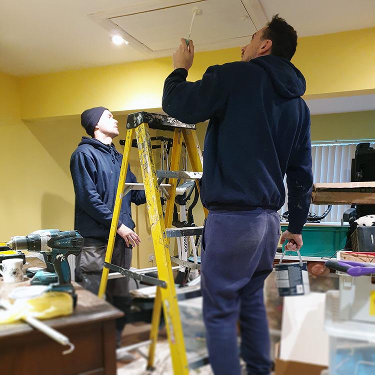 Team painting loft hatch door