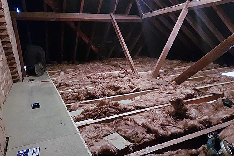 Loft with insulation hanging off