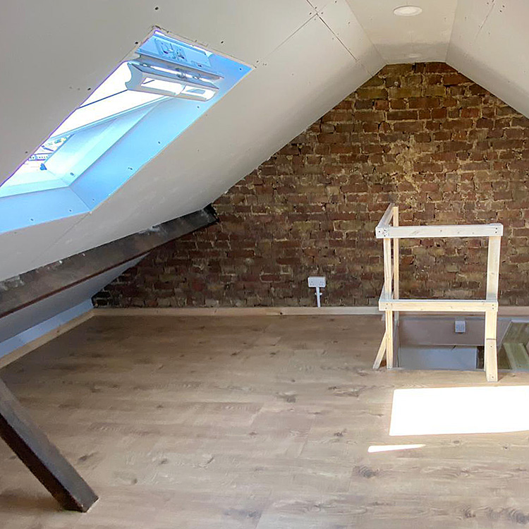 Crop of converted loft into storage room