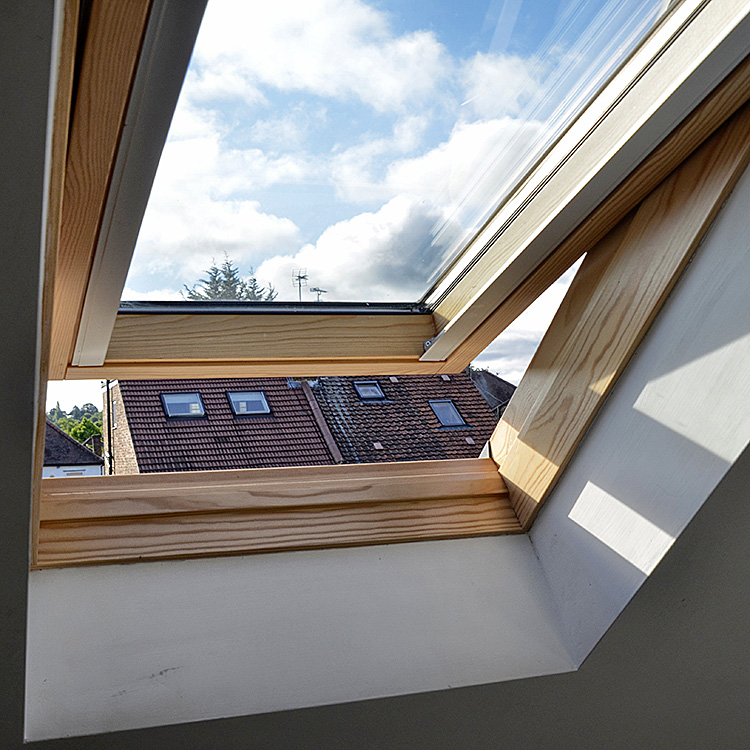 An opened Velux window with a wooden frame