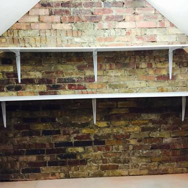 Loft shelving on bricks